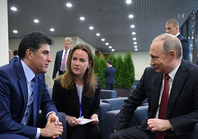 President Vladimir Putin and Prime Minister of the Kurdistan Regional Government of Iraqi Kurdistan Nechervan Barzani, left, meet at the ExpoForum exhibition center on the sidelines of the 2017 St. Petersburg International Economic Forum