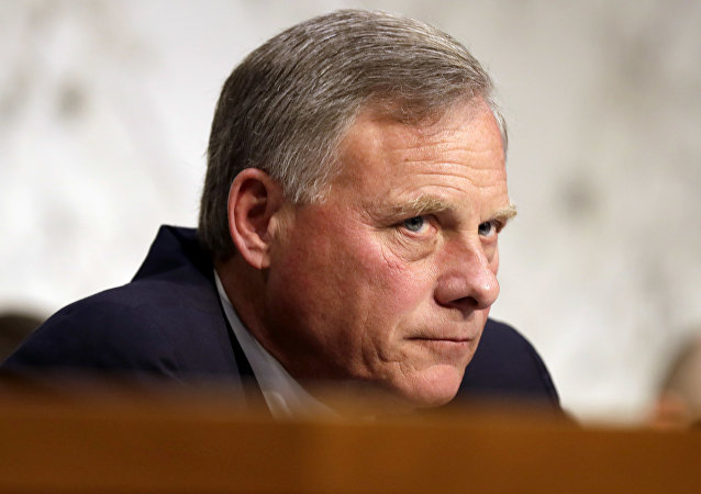 Senate Intelligence Committee Chairman Sen. Richard Burr, R-N.C. listens on Capitol Hill in Washington. Democratic lawmakers and rights groups criticized Burr on June 2, 2017, for seeking the return of copies of a report on CIA treatment of detainees after 9/11, saying he is trying to erase history