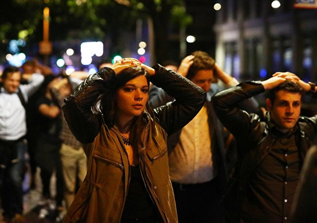 People leave the area with their hands up after an incident near London Bridge in London, Britain June 4, 2017