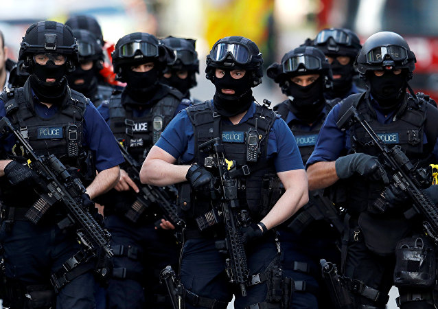 Armed police officers walk near Borough Market after an attack left 7 people dead and dozens injured in London, Britain, June 4, 2017