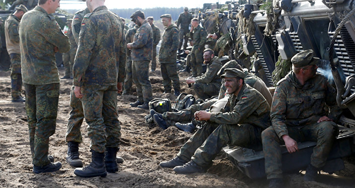 German army soldiers rest after NATO enchanced Forward Presence Battle Group Lithuania exercise in Pabrade military training field, Lithuania, May 17, 2017