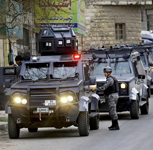 Jordanian security forces secure Hakama street during a raid in downtown Irbid, north of Amman, Jordan, Wednesday, March 2, 2016