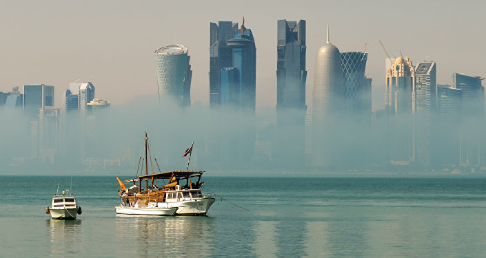 Mist burning off Doha Bay