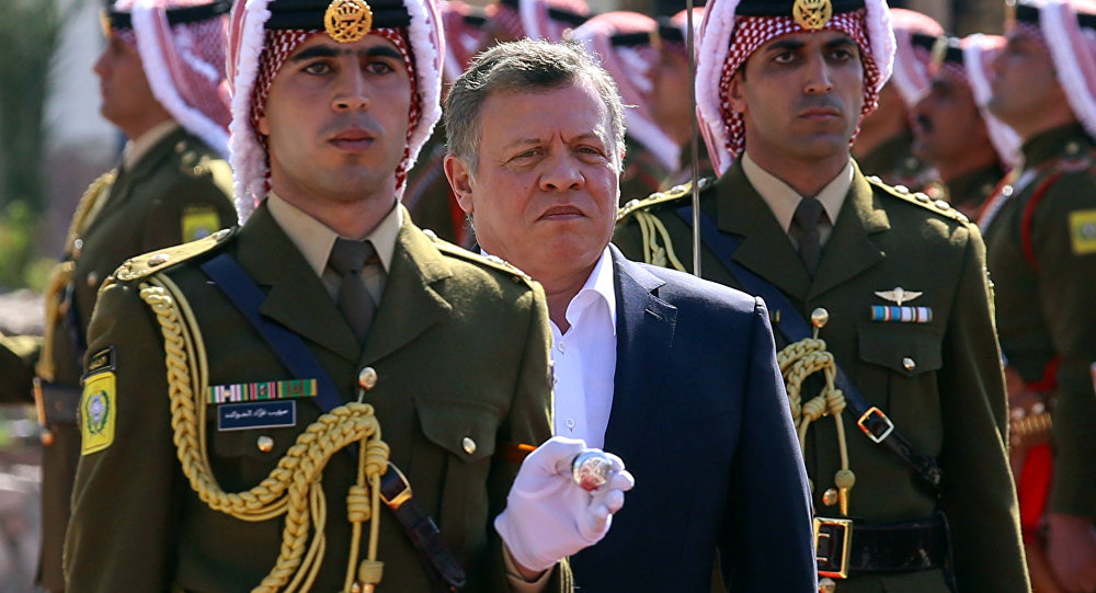 Jordan's King Abdullah II, second left, reviews an honor guard during a celebrations marking the centennial of the Arab Revolt against the region's ruling Ottoman Turks, in Jordan's Red Sea port of Aqaba, Saturday, Jan. 23, 2016.