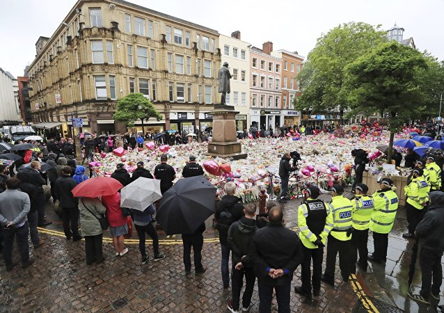 People observing a minute's silence in St Ann's Square, Manchester, England, in honor of the London Bridge terror attack victims, Tuesday June 6, 2017.