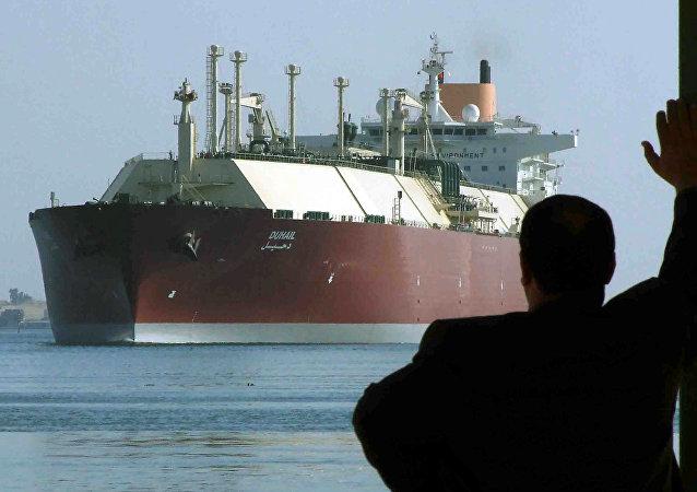 A man looks as the world's biggest Liquefied Natural Gas (LNG) tanker, Qatari-flagged DUHAIL as she crosses through the Suez Canal (File)
