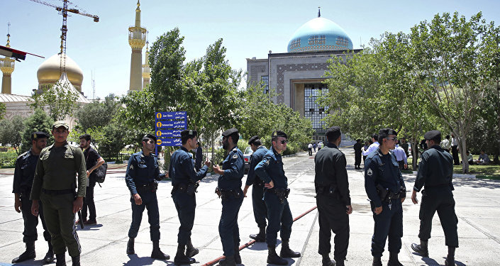 Police officers control the scene, around of shrine of late Iranian revolutionary founder Ayatollah Khomeini, after an assault of several attackers in Tehran, just outside Tehran, Iran, Wednesday, June 7, 2017