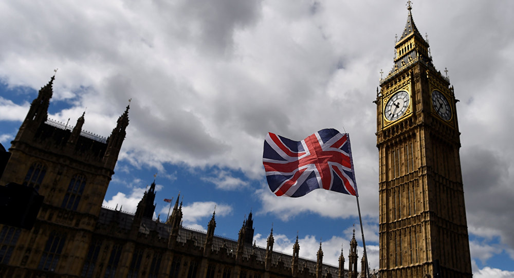 The Union Flag flies near the Houses of Parliament the day before a general election in central London, Britain June 7, 2017.