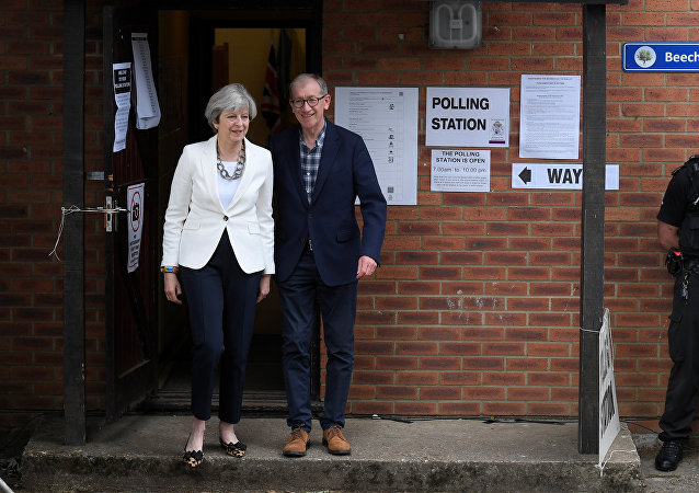 PM Theresa May arrives with her husband Philip to vote in Sonning, Britain June 8, 2017.