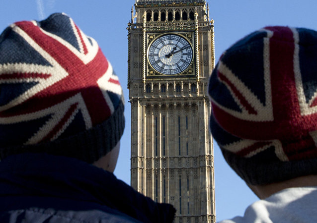 People wear Union flag-themed hats as they look at the Elizabeth Tower, better known as Big Ben, near the Houses of Parliament in London on January 17, 2017.