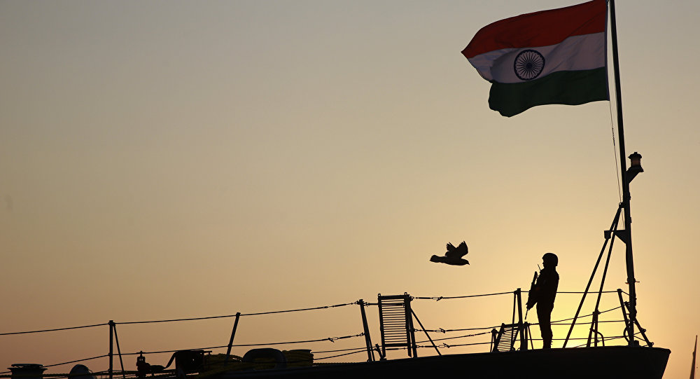 Indian navy person stands guard on board war ship Godavari during its decommissioning at the naval dockyard in Mumbai, India, Wednesday, Dec. 23, 2015