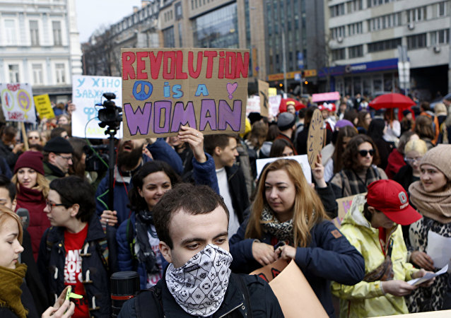 Ukrainian feminists march on the occasion of the International Women's Day in Kiev, Ukraine, Wednesday, March 8, 2017. Ukrainian feminists advocate for gender equality and protest against violence against women