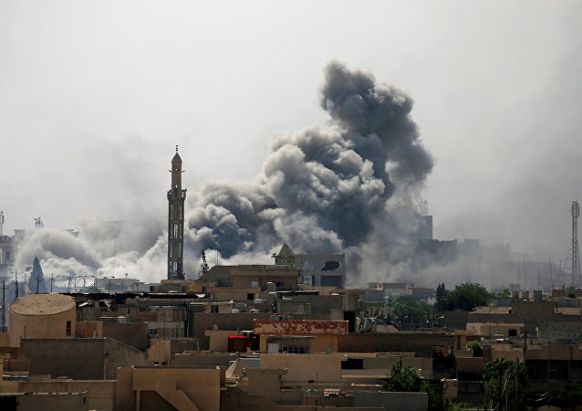 Smoke rises from an airstrike during a battle between Iraqi forces and Islamic State militants
