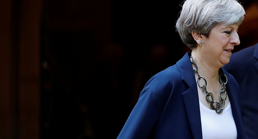 Britain's Prime Minister Theresa May leaves after a church service in Sonning, Britain June 11, 2017.