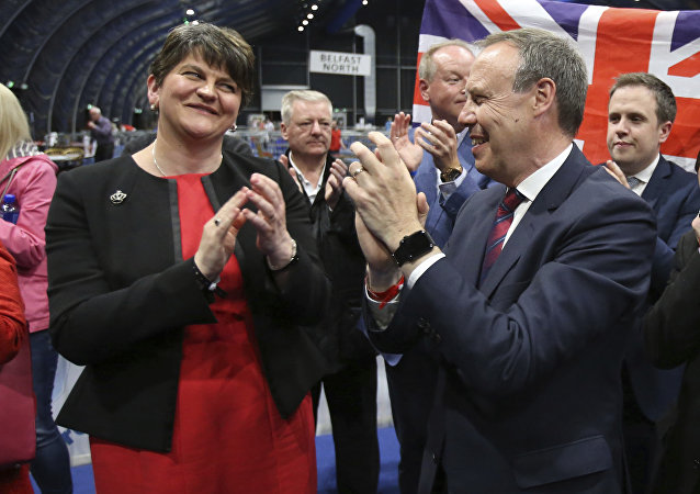 Democratic Unionist Party (DUP) leader Arlene Foster, left, and deputy leader Nigel Dodds cheer as Emma Little Pengelly is elected to the South Belfast constituency at the Titanic exhibition centre in Belfast where counting is taking place in the general election, Friday June 9, 2017.