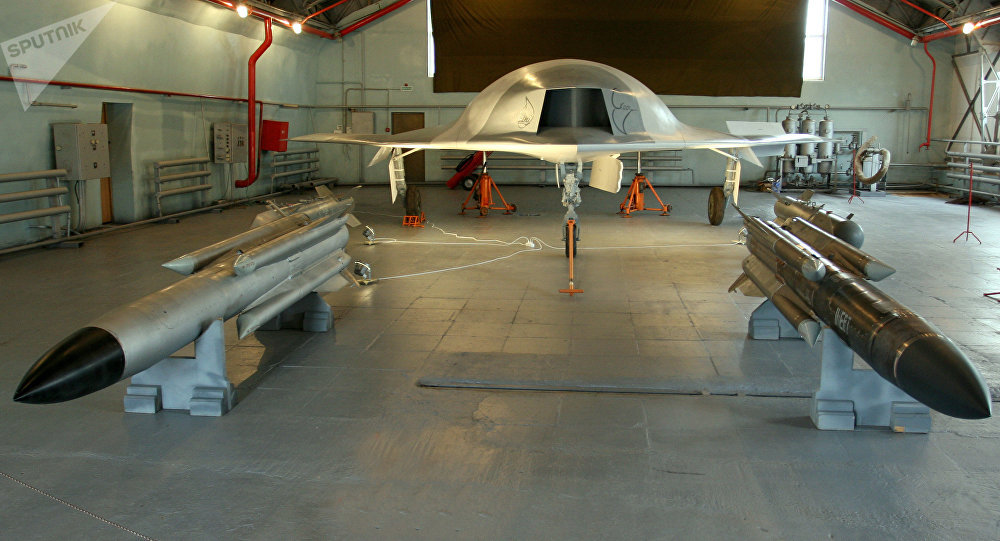 A full-sized model of the unmanned aerial vehicle Skat (background) and Kh-31 guided missiles (foreground) in a hangar of the Russian Aircraft Corporation MiG, the 8th MAKS-2007 air show in Zhukovsky