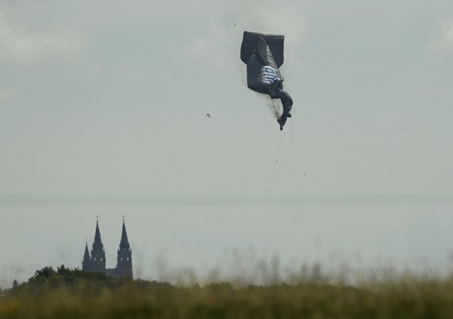 blimp crashes during the first round of the U.S. Open golf tournament Thursday, June 15, 2017, near Erin Hills in Erin, Wis. An official with the company operating the advertising blimp at the U.S. Open said the pilot is OK after the craft crashed but that he was taken to a hospital.