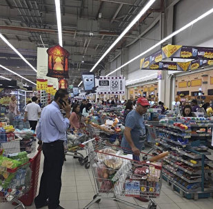Shoppers stock up on supplies at a supermarket in Doha, Qatar after Saudi Arabia closed its land border with Qatar, through which the tiny Gulf nation imports most of its food
