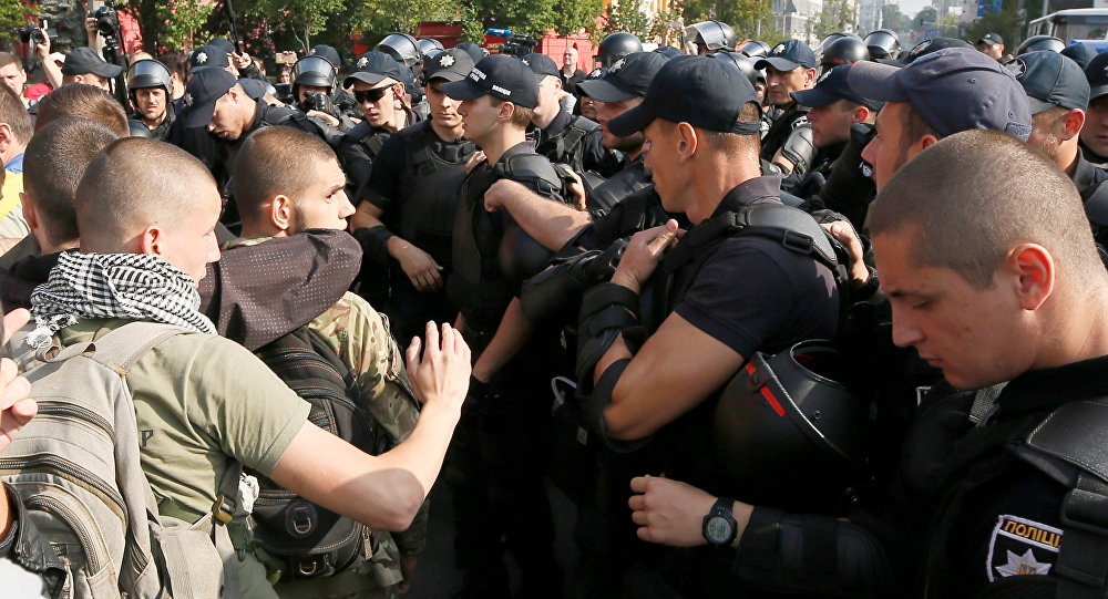 Police block anti-LGBT protesters during the equality march in Kiev, Ukraine