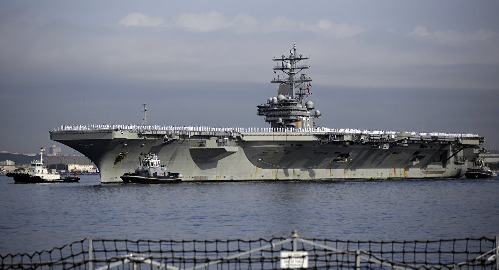 The aircraft was en route to the aircraft carrier USS Ronald Reagan in the Philippine Sea.