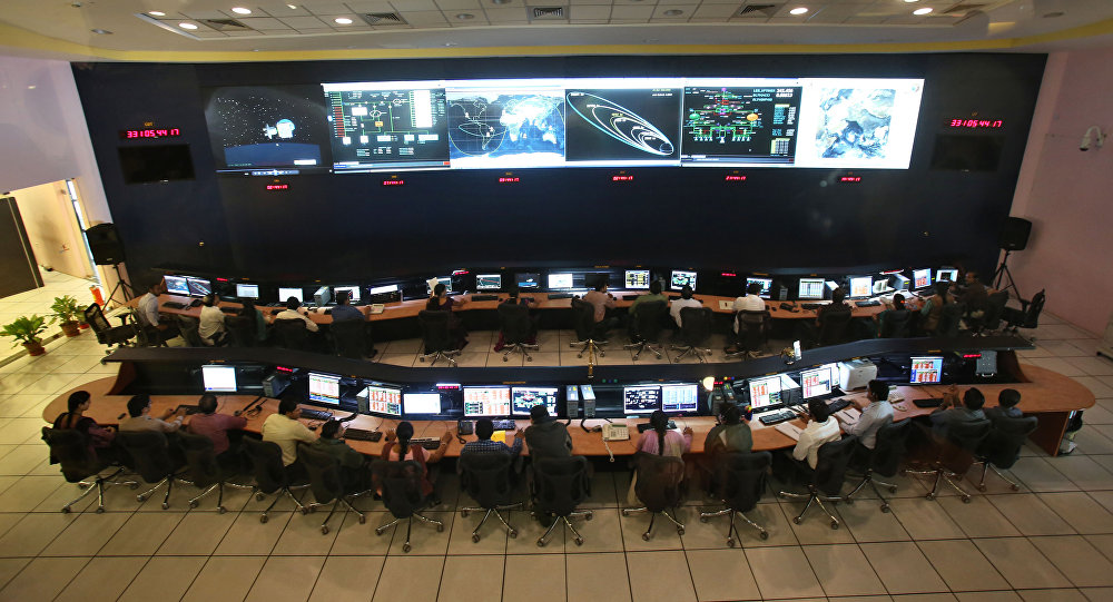 Indian Space Research Organization (ISRO) scientists and engineers monitor the movements of India's Mars orbiter at their Spacecraft Control Centre in Bangalore, India (File)