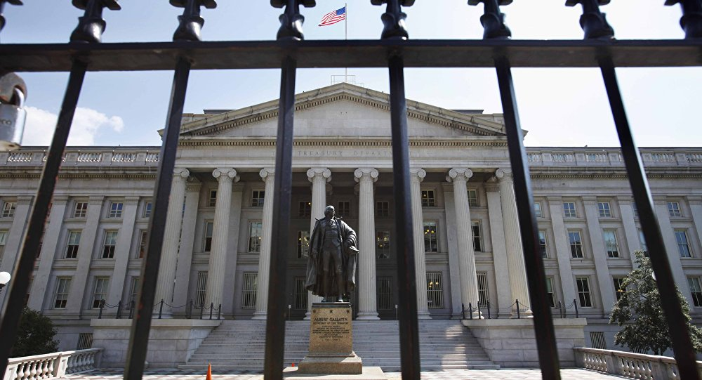 In this Monday, Aug. 8, 2011, file photo, a statue of former Treasury Secretary Albert Gallatin stands guard outside the Treasury Building in Washington