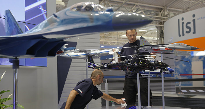 Employees clean the aircraft models at the Russian government company Rosoboronexport stand, at Paris Air Show, on the eve of its opening, in Le Bourget, east of Paris, France, Sunday, June 18, 2017