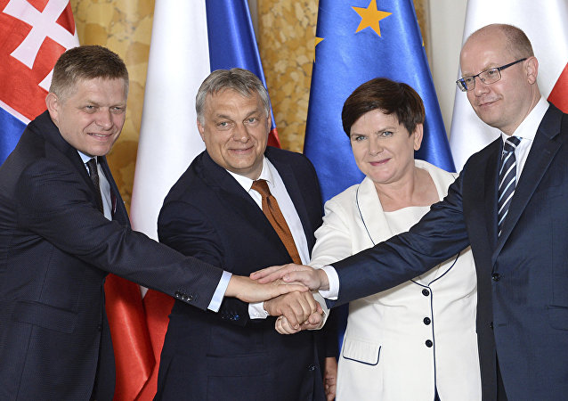 Prime Ministers of the four central European countries of the so-called Visegrad Group, Slovakia's Robert Fico, left, Hungary's Viktor Orban, second left, Poland's Beata Szydlo and Czech's Republic's Bohuslav Sobotka, right, shake hands during a ceremony of transferring the presidency of the Visegrad Group from Poland to Hungary, at the Royal Castle in Warsaw, Poland, Monday, June 19, 2017