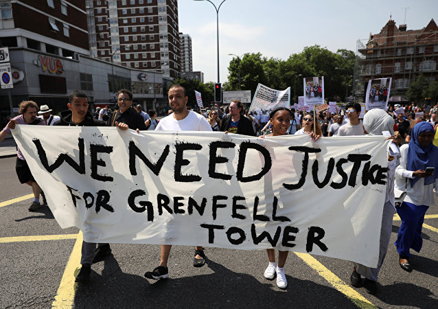 Demonstrators march during a protest about the Grenfell Tower fire, in London, Britain, June 21, 2017