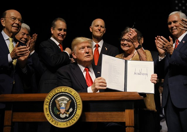 U.S. President Donald Trump is applauded after signing an Executive Order on US-Cuba policy at the Manuel Artime Theater in Miami, Florida, U.S., June 16, 2017