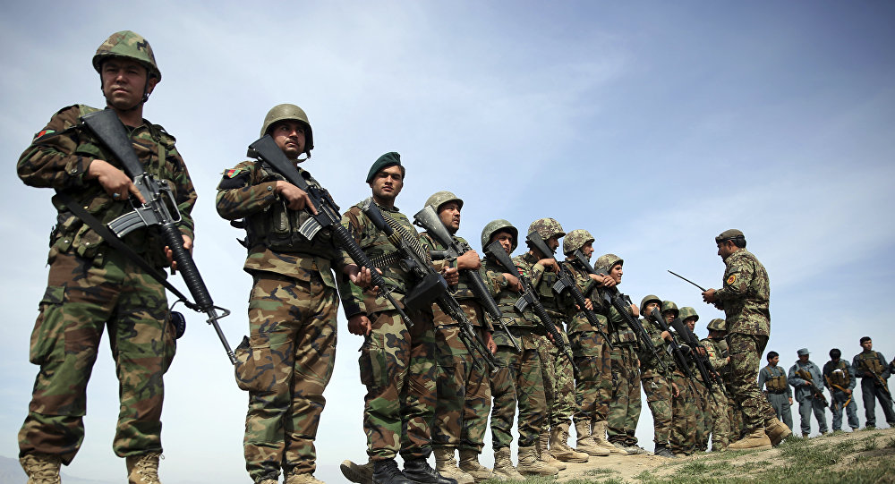 In this Tuesday, Mar. 15, 2016 file photo, Afghanistan's National Army soldiers stand guard, following weeks of heavy clashes to recapture the area from Taliban militants in Dand-e Ghouri district in Baghlan province, north of Kabul, Afghanistan