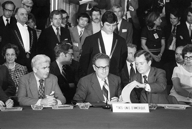 Dr. Henri Kissinger (C), US President Nixon's adviser on national security affairs, signs 13 June 1973 in Paris a ceasefire agreement bringing the Vietnam war to an end. The war ended 31 April 1975 when Saigon surrendered almost without fighting to the Viet Cong communist forces, ending the US's 15-year involvement in Vietnam.