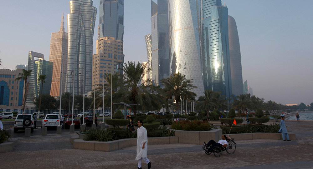 A man walks on the corniche in Doha, Qatar, June 15, 2017