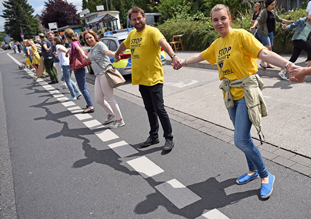 Participants of the anti-nuclear Chain Reaction demonstration build a human chain to protest against the operation of Belgium's Tihange 2 and the Netherland's Doel 3 nuclear power plants on June 25, 2017 in Aachen, western Germany, close to the border with Belgium and the Netherlands