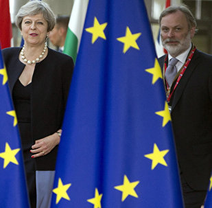 British Prime Minister Theresa May, left, and UK representative to the EU Tim Barrow arrive for an EU summit at the Europa building in Brussels on Thursday, June 22, 2017.