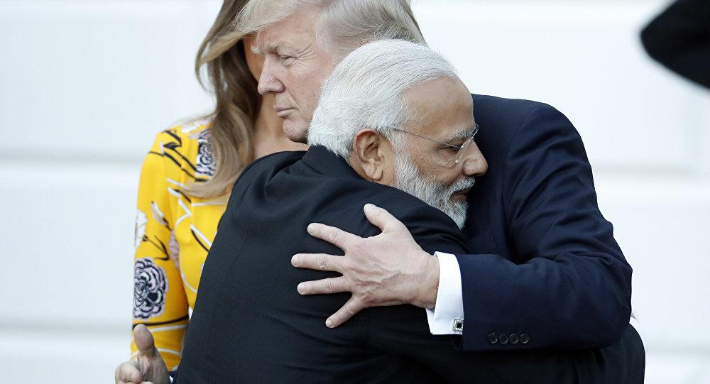 Indian Prime Minister Narendra Modi hugs President Donald Trump as Modi departs the White House, Monday, June 26, 2017, in Washington.