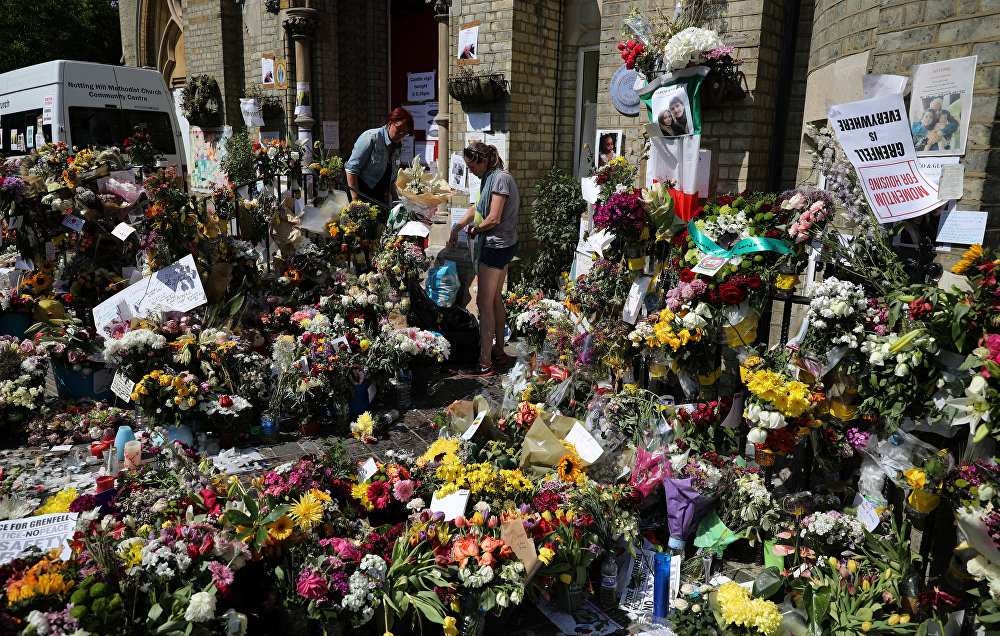 Floral tributes for the victims of the Grenfell Tower fire are left outside the Notting Hill Methodist Church, in London, Britain June 20, 2017.