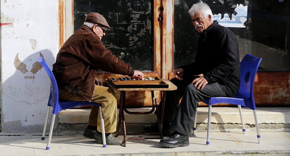 Men play backgammon in the Turkish Cypriots breakaway area at northern divided capital of Nicosia, Cyprus, Tuesday, Jan. 17, 2017.