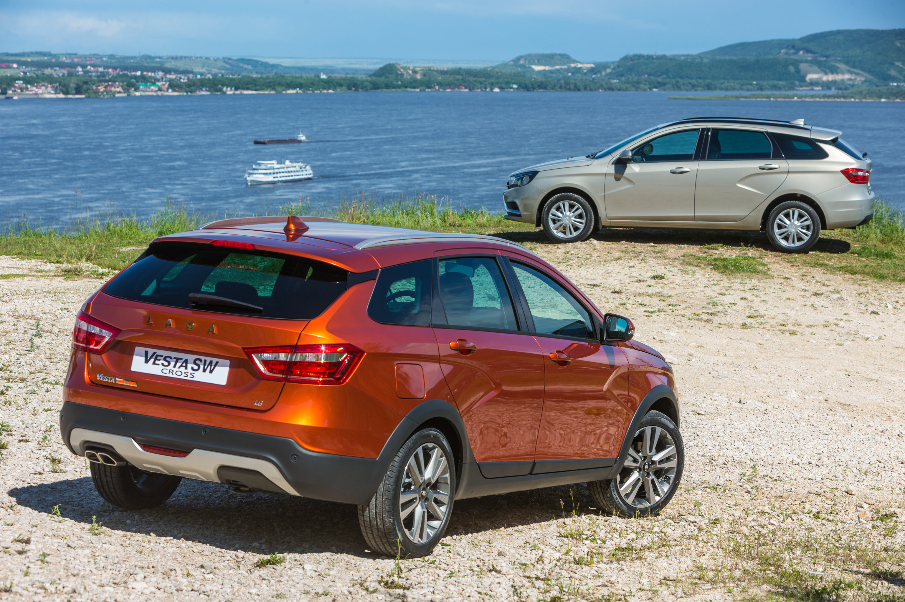 The new Lada Vesta SW Cross, foreground, and Lada Vesta SW wagons by AvtoVAZ