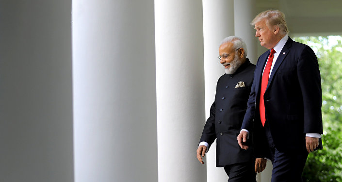 U.S. President Donald Trump (R) arrives for a joint news conference with Indian Prime Minister Narendra Modi (L) in the Rose Garden of the White House in Washington, U.S., June 26, 2017