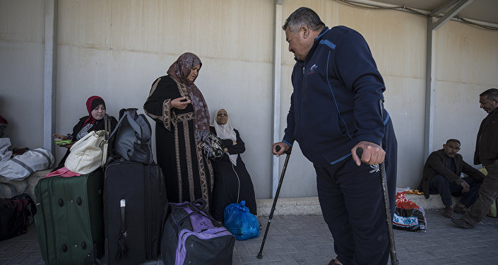 In this Sunday, March 26, 2017 photo, Palestinian residents of Gaza strip wait on the Israeli side of the Erez terminal to cross to Gaza Strip