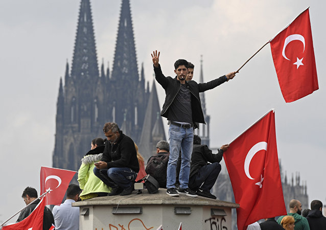 Turkish protesters demonstrate in Cologne, Germany, Sunday, July 31, 2016. Thousands of supporters of Turkish President Recep Tayyip Erdogan have gathered in the German city of Cologne for a demonstration against the failed July 15 coup in Turkey.
