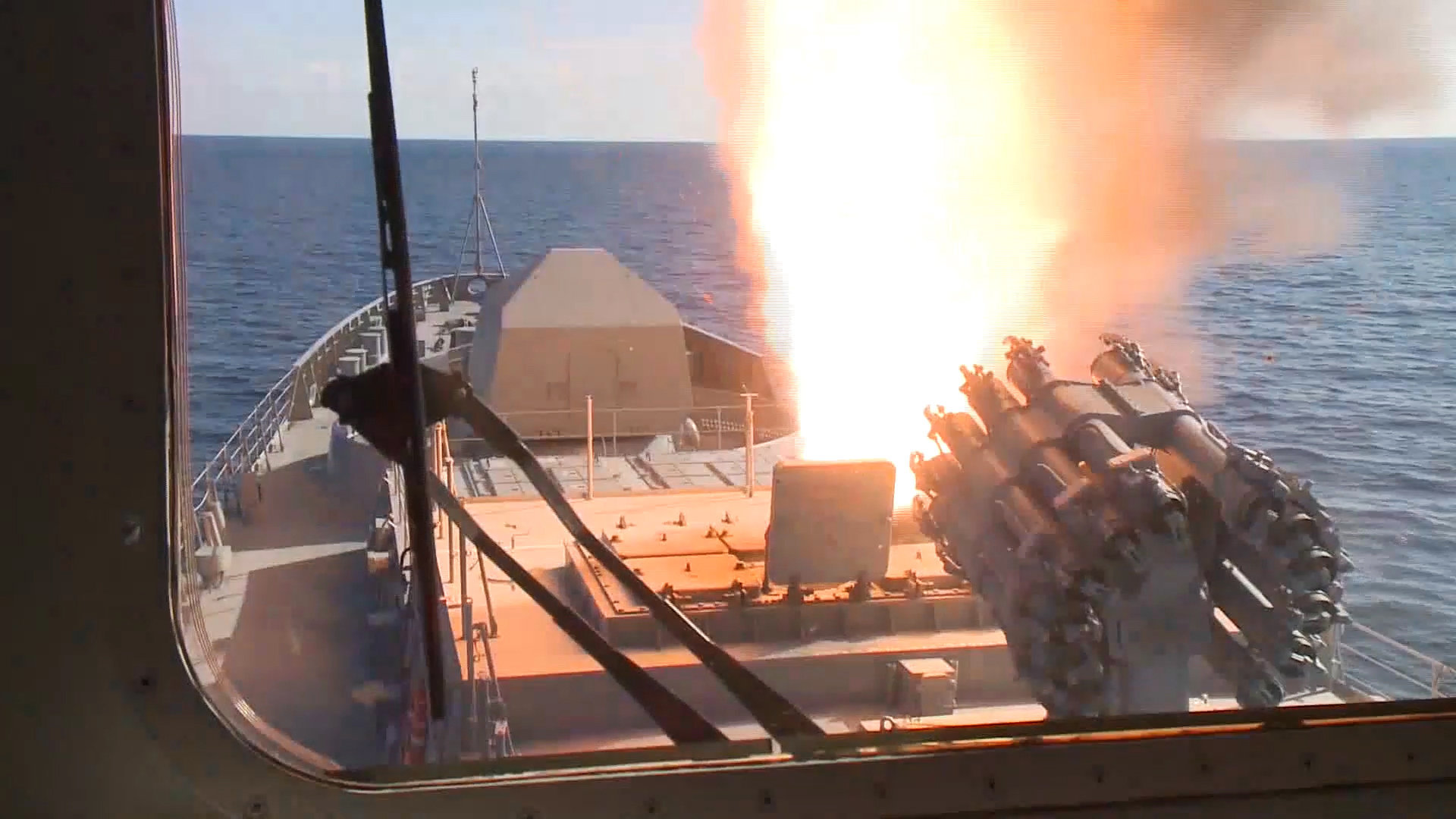 Admiral Grigorovich frigate launching its cruise missiles off the coast of Syria. RBU-6000 rocket launcher featured in the foreground.
