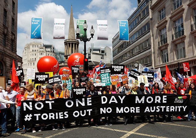 Demonstrators prepare to set off for Parliament Square on an anti-austerity rally and march organised by campaigners Peoples' Assembly, in central London, Britain July 1, 2017