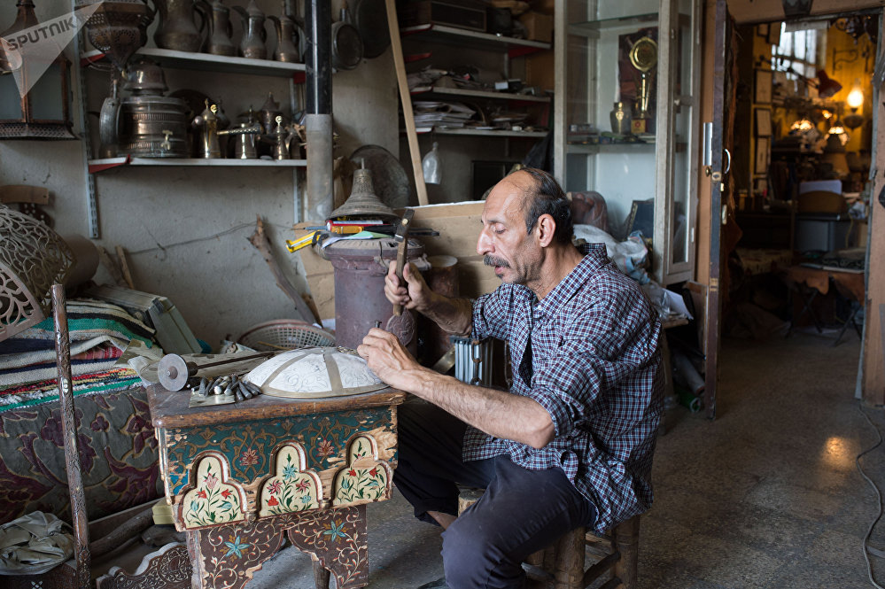 An engraver in a workshop in the suburbs Damascus
