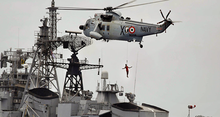 An Indian navy helicopter approaches an Indian navy ship while displaying rescue skills during a joint naval exercise with the Sri Lankan navy in Trincomalee, Sri Lanka (File)
