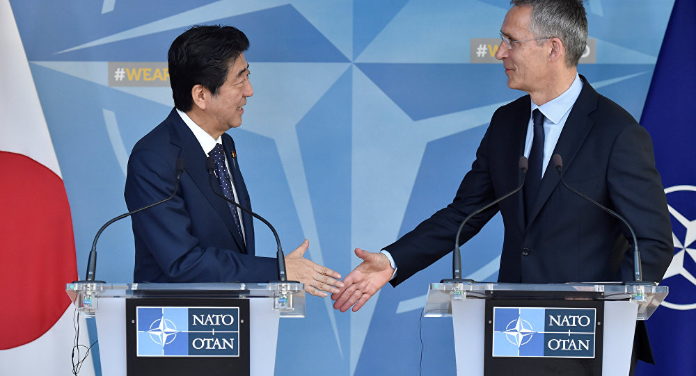Japanese PM Abe and NATO Secretary General Stoltenberg meet at NATO headquarters in Brussels.