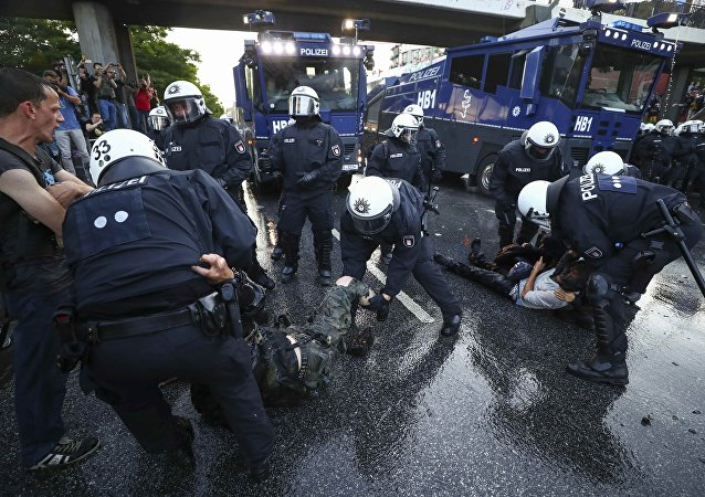 German riot police detain protesters during the demonstrations during the G20 summit in Hamburg, Germany, July 6, 2017