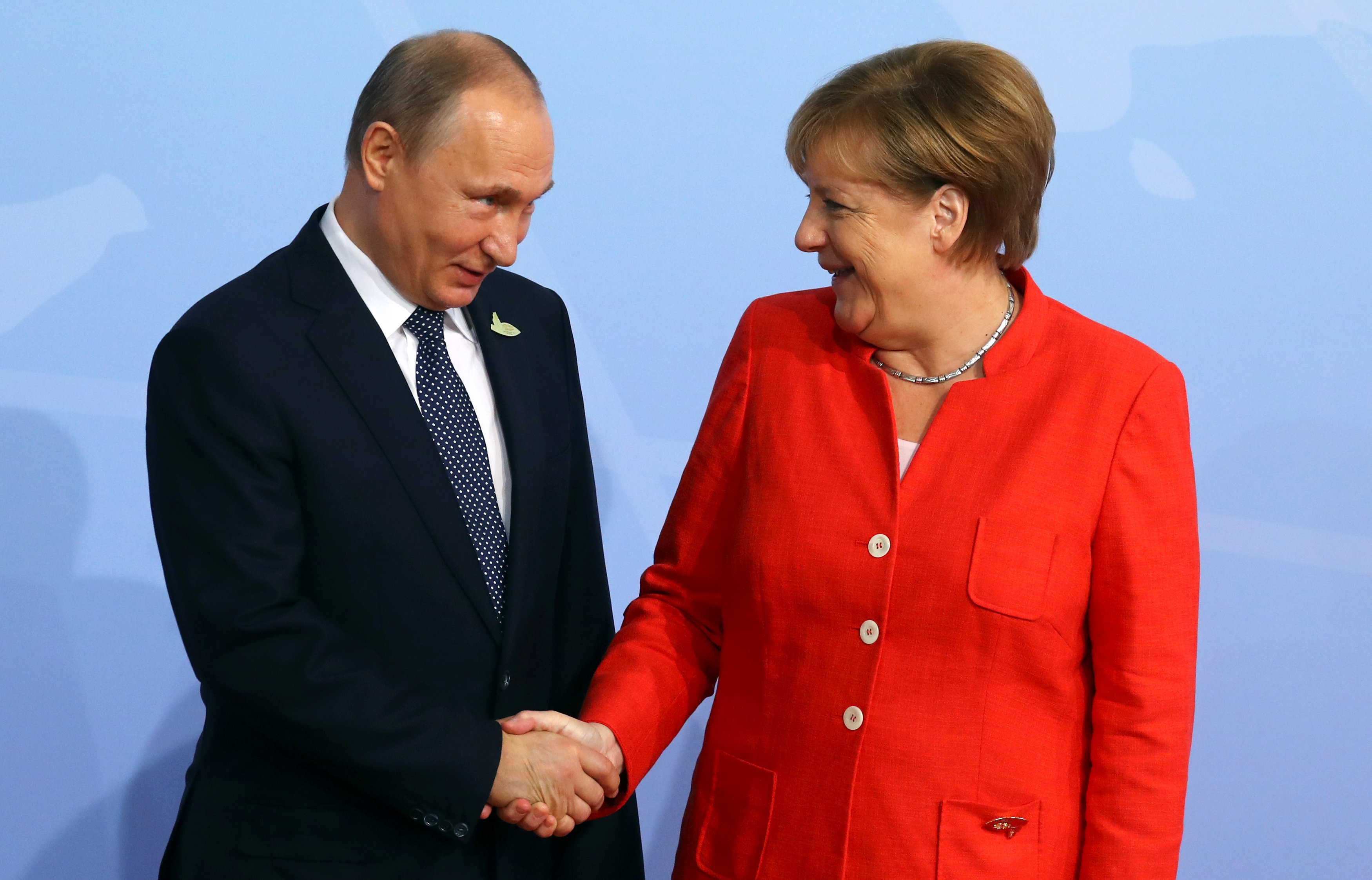 German Chancellor Angela Merkel greets Russian President Vladimir Putin as he arrives for the G20 leaders summit in Hamburg, Germany July 7, 2017