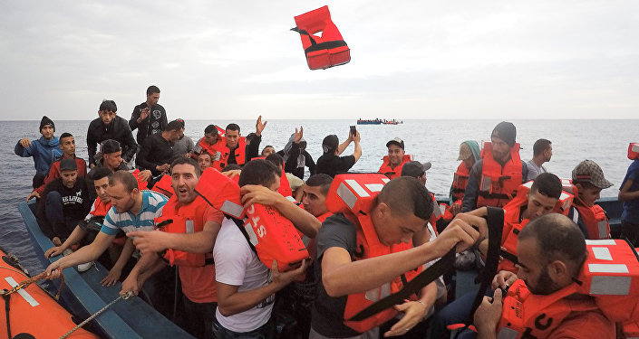 Migrants on wooden boat being rescued by Save the Children NGO crew from the ship Vos Hestia in the Mediterranean sea off Libya coast, June 18, 2017
